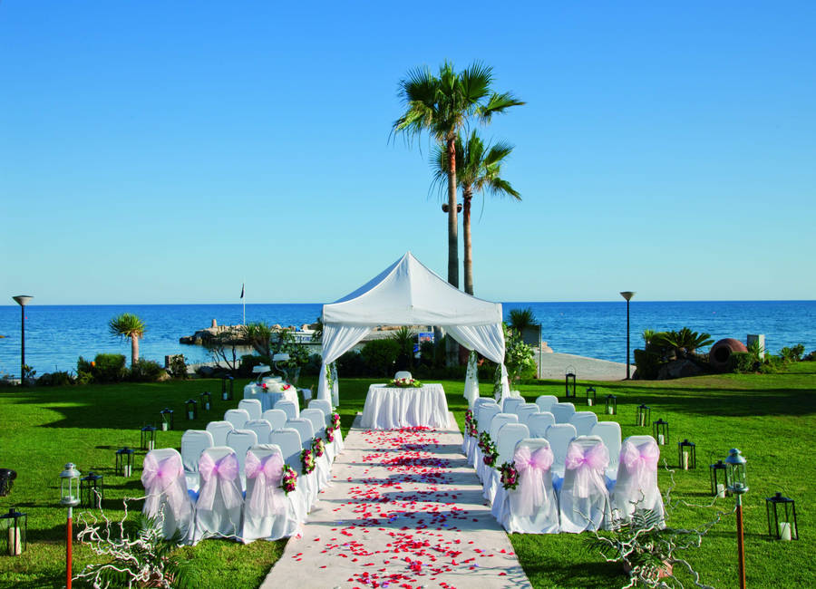 the ideal location for a hawaiian wedding would be outdoors mild weather or in