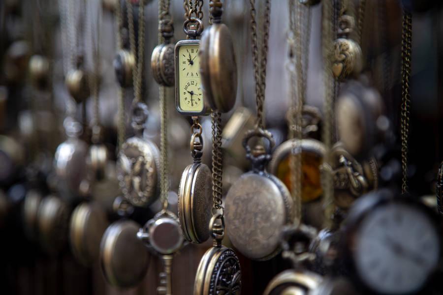 Girl holding  Vintage Clock in her Hand, Stockings, Dress, Alive in Wonderland Wallpaper
